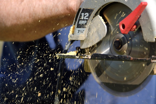 A circular saw with a spinning blade and saw dust
